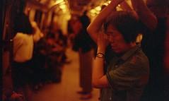 morning commute (Xingjian) Tags: redscale leicam6 voigtlander35mmf14noktonsc film singapore mrt