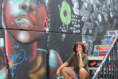 Lady Taking a Break in Comuna 13 (sally_byler) Tags: lady woman steps mural painting comuna 13 medellin colombia stairs