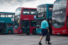 Arriva Enfield Garage (M C Smith) Tags: bus buses red blue parked man walking garage arriva enfield pentax k3 letters numbers symbols bag tarmac learners