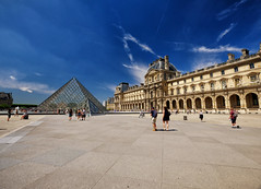 Pyramide du Louvre in Paris, France (` Toshio ') Tags: toshio pyramid louvre paris france french europe pyramidedulouvre impei courtyard museum museedulouvre alaisdulouvre people clouds fujixe2 xe2 palace history tourists