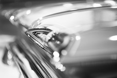 Intently (belleshaw) Tags: blackandwhite grandnationalroadstershow carshow classiccar taillights bumper rearend trunk horn chrome metal detail texture holes glass reflections abstract