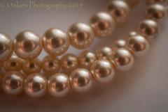 Shining (HMM) (13skies) Tags: jewelry macromondays sonyalpha100 sonya100 pearls colour shine approach macroscopic hmm decision shot close happymacromondays