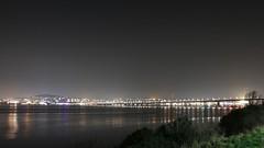Calm night view of the Firth of Tay (milnefaefife) Tags: image26100 100xthe2019edition 100x2019 firthoftay coast fife scotland tay newportontay sea night dundee dark reflections calm tayroadbridge thebraes streetlights lights stars