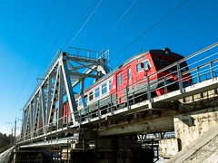 Passanger Suburban Train (St Basoff) Tags: olympus mft m43 zuiko 1122mm omd em12 train bridge sky sunny red contrast directpositive river snow spring russian railway
