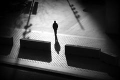 Through the Gap (joephoto uk) Tags: shadows man gap barrier southbank london silhouette