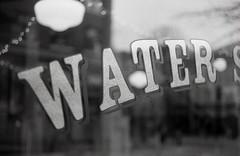 hydration (Yutaka Seki) Tags: water agua eau hydrogen oxygen window letter font word bokeh konicaautos2 kentmere400 blazinal rodinal homedeveloped blackandwhite