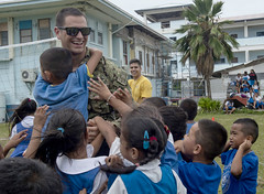 Lt. Sam Lieber interacts with students at Assumption School in Majuro, Marshall Islands.