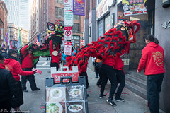 Enter the red dragons. (kuntheaprum) Tags: chinatownboston chinesenewyearcelebration yearofthepig sony a7riii tamron 2470mm f28 festival parade dragon firework