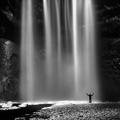 Skógafoss No. 4 (Mabry Campbell) Tags: europe iceland scandinavia skogafoss skógafoss southiceland southerniceland blackandwhite cliff fineart fineartphotography ice image landscape longexposure monochrome mountain person photo photograph photography silhouette snow squarecrop water waterfall f71 mabrycampbell april 2013 april132013 201304130h6a0502 40mm 80sec 100 ef1740mmf4lusm