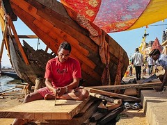 Locals handcraft wodden boats by the Ganges river in Varanasi, India. It was great to walk by him multiple times and witness the amazing progress on his boat. . #Storytelling #Handcraft #India #EverydayIndia (Renzo Grande) Tags: photography streetphotography street documentary photograph photo