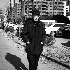 Hand in my pocket (Go-tea 郭天) Tags: qingdao shandong républiquepopulairedechine cn huangdao cold winter morning sun sunny shadow man old walk walking alone lonely cap hands pocket street urban city outside outdoor people candid bw bnw black white blackwhite blackandwhite monochrome naturallight natural light asia asian china chinese canon eos 100d 24mm prime portrait