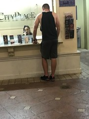 Man using Customer Service (LarryJay99 ) Tags: cityplace ttop man men guy guys dude male studly manly dudes people virile tanktops shoulders existinglight sexyguy shorts legs