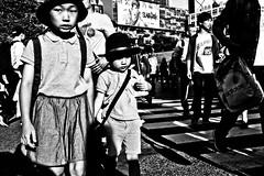 Shibuya Moment (Victor Borst) Tags: street streetphotography streetlife reallife real realpeople asian asia asians fa faces face candid travel travelling trip traveling ur urban urbanjungle urbanroots blackandwhite bw mono monotone monochrome kids child children japan japanese tokyo mo happyplanet asiafavorites