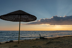 Lonely sunshades (Through_Urizen) Tags: category erdek hdr kapidag places seascape sunset turkey canon canon70d sigma1020mm outdoor seashore seaside beach coast coastal sand waves parasol beachlife cloud sky sunrays sunglow evening landscapephotography travelphotography marmarasea erdekbay