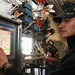 Sailor operates a weapons elevator in the hangar bay of USS Harry S. Truman.