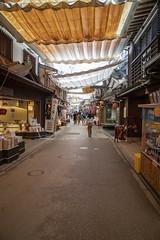 Omotosando shopping street at Miyajima (fnks) Tags: asia japan tokyo hiroshima miyajima island sea trees ropeway shrines buddhism temples ferry sky deer beach tides tanterns water sunshine mountains