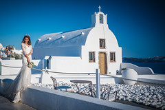 """Fairytale wedding Santorini Greece (Ron Harbin Photography) Tags: model girl hair long short bokeh gorgeous smile grin color yellow red black blue outdoor lightroom people diffused light sunshine shade natural eyes teeth glamour wedding skin getty piercing soft art depth field pictures summer 2017 f28 24mm d750 fx nikon copyright dress clothes top bottom flower escape fairytale wonderland """"natural light"""" photographer golden greece santorini church orthodox greek"""