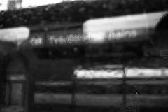 Impressions of Yverdon-les-Bains  (Film) (Harald Philipp) Tags: train window dark schwarzweiss kodak retinaiiic film analog ilford delta400 railway trainstation travel rain rainy gloomy journey haraldphilipp urban street abstract sign yverdonlesbains switzerland blackandwhite bw monochrome 35mmfilm 135film primelens nikon coolscan9000ed city blur defocus noir sbb schweiz schneiderkreuznach rangefinder foldingcamera