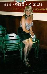 Bleacher Bum (Laurette Victoria) Tags: laurette woman blonde patternedhose kerchief mini animalprint bustier bosom