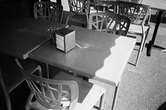 Tables and chairs (Matthew Paul Argall) Tags: hanimex35es fixedfocus 35mmfilm blackandwhite blackandwhitefilm kentmerepan100 100isofilm table chairs