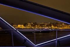 Irregular frame (cigno5!) Tags: blue amsterdam amstedamlightfestival jjvanderveldebrug night rain skyline canal bridge nemo fluorescent water yellow