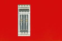 Window in a orange red wall (Jan van der Wolf) Tags: map167309vv grancanaria composition window raam simple simp wall muur facade crucedearinaga bars tralie orange red rood oranje minimalism minimalistic trellis