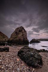 Rock and a Hard Place (Mark Boadey) Tags: wales rainbow anglesey brick bricks coast works sea porthwen seastack bay