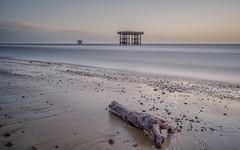 The Drifter (Merrik76) Tags: suffolkcoast sizewell nuclear power station inlet outlet cooling pump northsea beach seascape waves pebbles driftwood longexposure leefilters fuji xt3 16mm