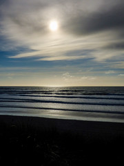 A Flat Light (Steve Taylor (Photography)) Tags: newzealand nz southisland canterbury christchurch northnewbrighton waves sea pacific ocean beach glow cloud sky sun