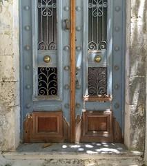 (kamphora) Tags: summer wood doorknob brass rust old blue door fiskardo kephalonia greece ironwork paint peeling doorknocker ornate