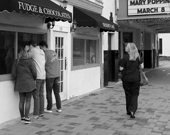 The Lure of Chocolate (tvdflickr) Tags: pedestrian man woman male female shoppers sidewalk city candy chocolate street georgia marietta curious lure tvdimages photobytomdriggers thomasdriggersphotography fuji fujifilm x100f fujifilmx100f rangefinder