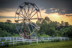 Abandoned Ferris Wheel (donnieking1811) Tags: tennessee huntsville ferriswheel abandoned fence trees sky clouds outdoors hdr canon 60d lightroom photomatixpro