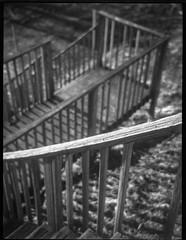 looking down, wooden stairway, zig-zag movement, Asheville, NC, Zenobia, Arista.Edu 200, Ilfod Ilfosol 3 developer, 1.7.19 (steve aimone) Tags: lookingdown stairs stairway wooden zigzag railings asheville northcarolina zenobia aristaedu200 ilfordilfosol3developer folder 645 120 120film film mediumformat monochrome monochromatic blackandwhite