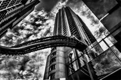 Umbilical Cord (Peter Polder) Tags: australia alley architecture bw buildings city cityscapes cityscape cityview exterior sky skyline light monochrome mono sydney street skyscraper