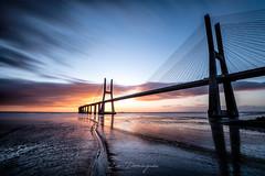 Sunrise bridge (ivo.domingues) Tags: sky water sea bridge man made structure built cloud architecture horizon over engineering outdoors sunrise lisbon reflection low tide shadows