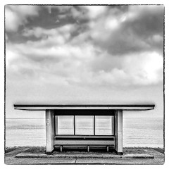085 Shelter (georgestanden) Tags: blackandwhite black white monochrome desaturated photo photography photograph bnw iphone mobile mobilephone iphonephotography iphonephoto iphonephotographer art picture photooftheday blackwhite iphone6s shelter promenade llandudno northwales wales welsh architecture building clouds sea water beach sky seascape landscape seat bench