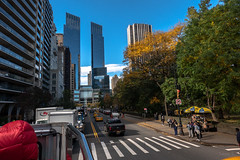 Red Head in the Way (Jocey K) Tags: sonydscrx100m6 triptocanadaandnewyork hoponhopoffbus trees autumn centralpark sky architecture buildings cars cabs taxi street road peole bus newyorkcity