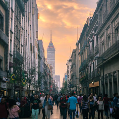 Magical Sky in Mexico City (GlobalGoebel) Tags: psychedelic iphone iphoneography iphonex ciudaddeméxico mexico mx iphone10 cdmx mexicocity street pedestrians streetphotography sunset vanillasky colorful clouds clocktower skyscraper torrelatinamericana tower latinamerica clock smog travel travelphotography