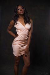 Pretty In Pink (Fly Sandman) Tags: model modelshoot woman shortdress omaha nebraska pink longhair legs flash offcameraflash strobes studio indigocarroll