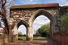 14thC gateway ruins, Augustinian Abbey of Holy Cross, Waltham Abbey, Essex, England. (edk7) Tags: olympuspenliteepl5 edk7 2016 uk england essex walthamabbey 14thcgatewayruinsaugustinianabbeyofholycross architecture building oldstructure medieval lategothic sky cloud park lawn tree brick stone limestone arch stonecarving abandoned gate door