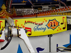 American Swing Scenery Panel. (dccradio) Tags: myrtlebeach sc southcarolina horrycounty americanswing musicride himalaya flyingbobs thunderbolt scenerypanels lights amusementpark amusementride nikon coolpix l340 bridgecamera carnival midway fairride amusements amusementdevice mechanicalride ride rides thrillride outdooramusement fun entertainment outdoors outside february winter monday mondaymorning morning goodmorning broadwayatthebeach park vacation destination tourism tourist bertazzon swingbuggy pavilionpark pavilionparkcentral pavilionamusementpark pavilionamusementparkcentral