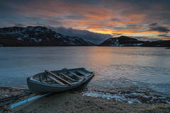 Icy at Ruthven. (Gordie Broon.) Tags: lochruthven icyloch croachy sunset fishingboat stacgorm craigruthven tullich scottishhighlands scotland schottland scenery landscape paysage ecosse paisaje escocia invernessshire beach collines hills chilly atardecer lecoucherdusoleil sonnenuntergang frozenloch lago lac gordiebroonphotography hugeln farr abersky dalcrombie sonya7rmkii ilce7rm2 sonyzeiss1635f4lens sky clouds february 2019 winter scenic scozia szkocja geotagged brin ballachar unning