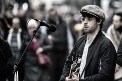 Busker (Frank Fullard) Tags: frankfullard fullard candid street portrait busker musician guitar flute cap stubble beard dublin graftonstreet irish ireland colour color player guitarist singer performer artist entertainer