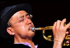 Blowin' In The Wind .... (daystar297) Tags: portrait streetportrait musician music jazz blues trumpet asian horn performance nyc washingtonsqpark