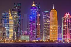 Doha Nights (roevin | Urban Capture) Tags: doha qatar qa city sunset orange road traffic grid lighting building evening high floor roads select downtown district outlook urban new river reflections twilight skyscrapers skyscraper nightshot nightpf