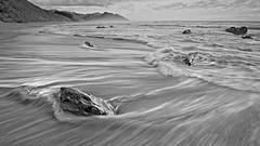 The wave recedes (dave.fergy) Tags: coast sunrise dawn rocks black white monochrome waves seascape