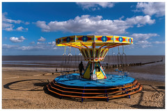 clee beach carousel ride (Mallybee) Tags: fuji fujifilm xt30 apsc xtrans xmount mallybee 18135 fujinon f3556 ois zoom 18135mm cleethorpes outside beach shadows colour sea sky ride carousel blue yellow vintage