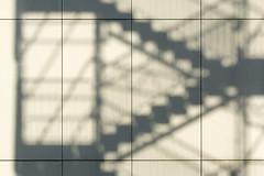 Shadowplay of a stairway (Jan van der Wolf) Tags: map185181v shadow schaduw shadowplay stairs staircase stairway trap trappen schaduwen schaduwspel monochrome monochroom lines lijnen lijnenspel interplayoflines