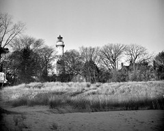 Black & White Film Photography: Grosse Point Lighthouse & Beach (LUB_0033) (masinka) Tags: etbtsy lighthouse beach sand fence shoreline shore lakeshore michigan lake greatlakes historic blackandwhite bw monochrome film analog photography travel evanston chicago