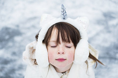 Unicorn girl, summoning her powers (Elizabeth Sallee Bauer) Tags: believe child childhood children cold dreaming family fantasy frozen fun girl happiness horn ice kid magic makebelieve outdoors outside playing roseycheeks snow unicorn white winter youth